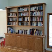 "Finished bookcase with 7 1'2"" stainless steel pulls."