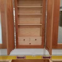 Medicine cabinet has adjustable Maple shelves and drawers.