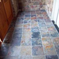I installed the multi-colored slate tile after the door unit was complete.