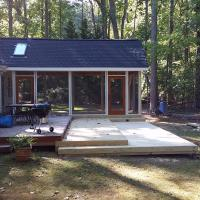 Screened porch with tiered decks.