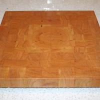 "Square board with quarter grain match. 14"" square and 1 1/2"" thick."