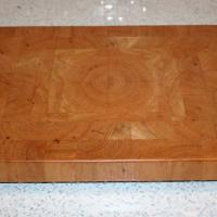 Rectangular Cherry board with quarter matched grain in the center.