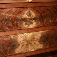 Book matched crotch grain drawer fronts.