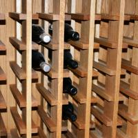 Upper storage will accommodate one case per vertical section.