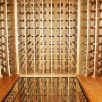 Upper storage for standard bottles.